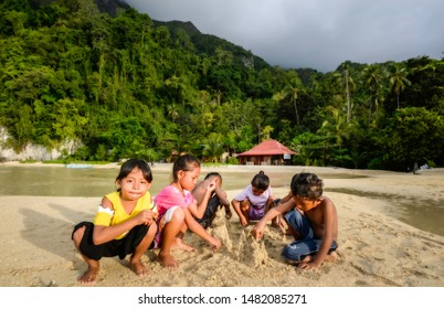 Ambon-Indonesia, Agustus 2018; Beach children making sand castle at tropical beach, Saleman Seram island.