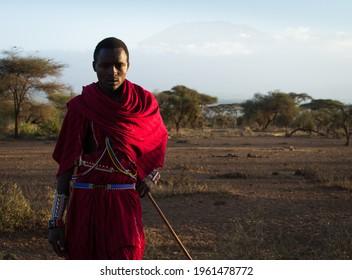 Amboseli Kenya March 15 2020 Year Masai shepherd with Kilimajaro background in the evening light