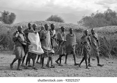 AMBOSELI, KENYA - OCT 13: Group of unidentified African men from Masai tribe prepare to show a traditional Jump dance on Oct 13, 2011 in Masai Mara, Kenya. They are nomadic and live in small villages.