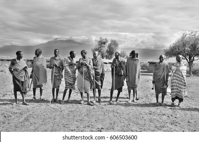 AMBOSELI, KENYA - OCT 13: Unidentified African people from Masai tribe prepare to show a traditional Jump dance on Oct 13, 2011 in Masai Mara, Kenya. They are nomadic and live in small villages.