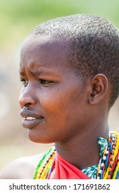 AMBOSELI, KENYA - OCTOBER 10, 2009: Portrait of an unidentified Massai woman in typical tribal clothes in Kenya, Oct 10, 2009. Massai people are a Nilotic ethnic group