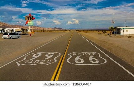 Amboy, California - 09-10-2015: World famous and historic Route 66 signs on road at iconic Roy's Motel and Cafe in Amboy, California
