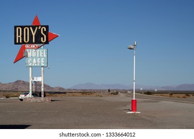 AMBOY (CALIFORNIA), USA - AUGUST 8. 2009: Isolated sign of Roy´s Motel and cafe against blue sky at Route 66