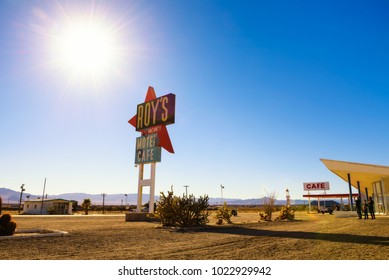 Amboy, California, USA - December 27, 2017 : Roy's motel and cafe with vintage neon sign on historic Route 66 in the Mojave desert.