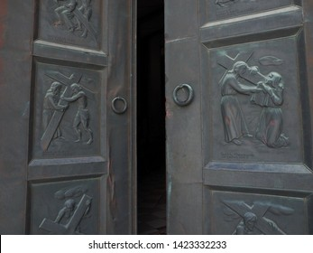 Ambrogio, Italy - June 6, 2019. Chiesa dell'Annunziata. A first church is attested in 1188, the current church was built in 1961. Entrance with bronze door, work by Egidio Casagrande.