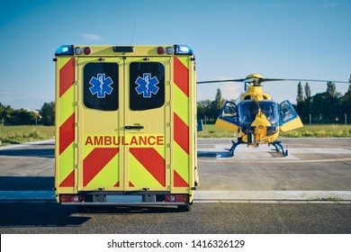 Ambulance car against helicopter of emergency medical service. Themes rescue, help and hope.