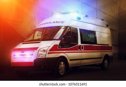 ambulance car on blured background at sunset. Ambulance auto paramedic emergency.