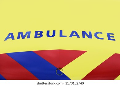 Ambulance (dutch, netherlands) Vehicle which helps people in need who are injured. Name written on the van.