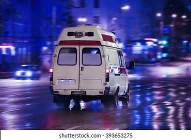 ambulance goes on the night rainy city