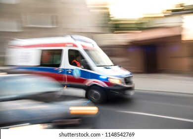 Ambulance in motion driving down the road in the city. Intentional motion blur