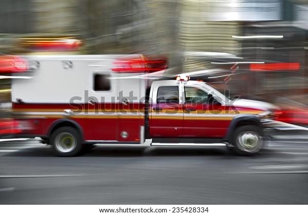 ambulance on emergency call in motion blur