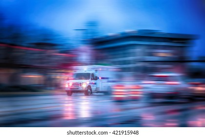 an ambulance racing through the rain on a stormy night with motion blur (NO SHARP FOCUS DUE TO RAIN and slow shutter speed) with reflections in the road