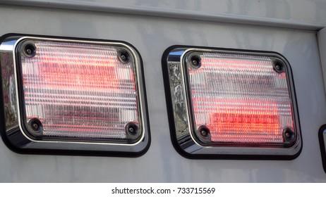 Ambulance red flashing lights still photo warning vehicles on road of emergency medical situation