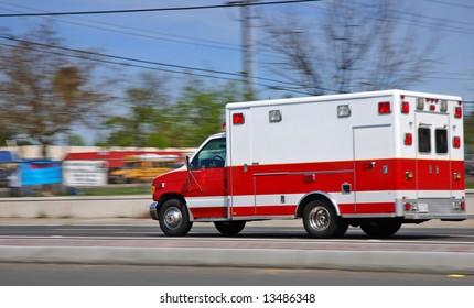 Ambulance speeding on an American street heading to an emergency