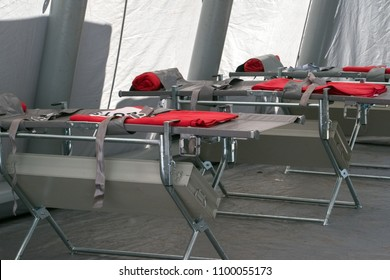ambulance tent with modern medical emergency beds for first aid on an event or festival, selected focus, narrow depth of field