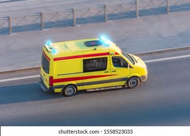 Ambulance van fast ride on highway, aerial view