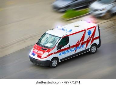 Ambulance van with flashing lights
