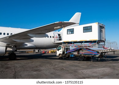 Ambulift truck for people with disabilities is at the passenger airplane