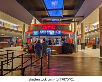 AMC cinema movie theater lobby, snack bar customers waiting in line, Danvers Massachusetts USA, August 14, 2019
