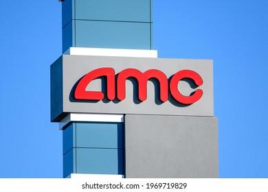 AMC sign, logo advertises AMC movie theater on a sunny day under blue sky - Sunnyvale, California, USA - 2021
