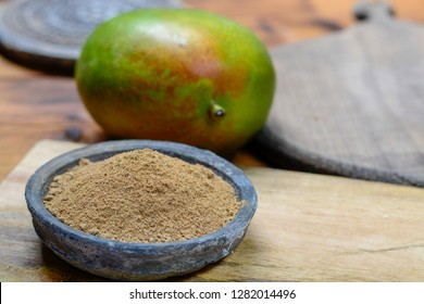 Amchoor or aamchur, mango powder, fruity spice powder made from dried unripe green mangoes in India, used to flavor foods close-up