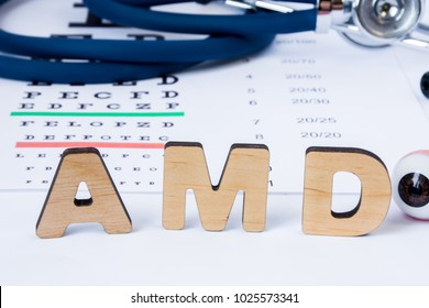 AMD Abbreviation or acronym of age-related macular degeneration - eye problem in older persons. Word AMD is on foreground near eye model with stethoscope and visual acuity test on blurry background