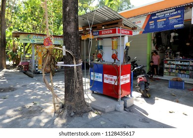 Amed, Bali – July 1 2018: A small Pertamina petrol (gas) station on the coast road near Amed on the island of Bali, Indonesia