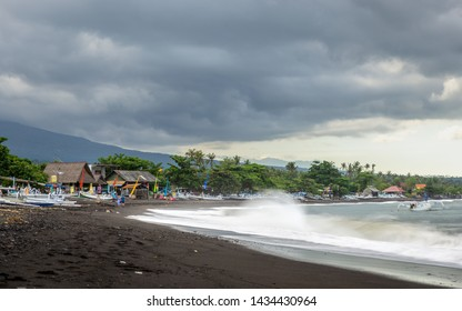 AMED, INDONESIA - CIRCA MARCH 2019: Stormy weather over Amed Beach in the east coast of Bali.