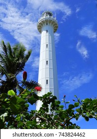 amedee island lighthouse with tropical foliage on a sunny day on amedee island, near noumea, new caledonia, in the south pacific
