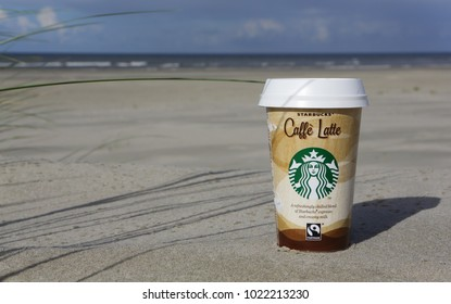 Ameland, Dutch - 10 February 2018.: A cup of Starbucks coffee. Starbucks is the world's largest coffee house with over 20,000 stores in 61 countries.