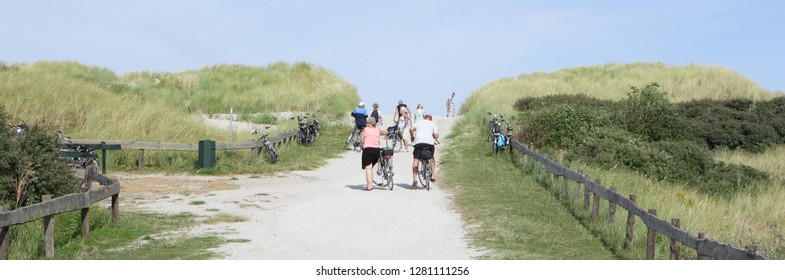 Ameland, Dutch - 10 October 2016.: Bike route on island Ameland and people