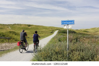 Ameland, Dutch - 10 October 2016.: Bike route sign FIETSPAD on island Ameland and people