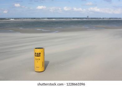Ameland, Dutch - 13 November 2018.: Oil filter CAT on the North Sea beach. Eco problem.