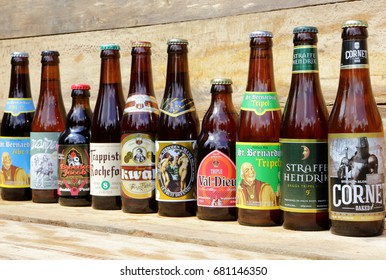 AMELAND, DUTCH - 14 November 2016.: Bottle of Cornet Oaked blond beer  on a wooden background and many other.