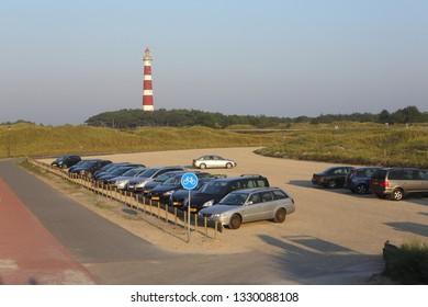 Ameland, Dutch - 14 September 2016.: Parking place on island Ameland. Honda car and many other.