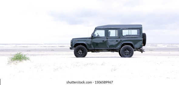 Ameland, Dutch - 15 September 2019.: Land Rover Defender on North Sea beach. The iconic and legendary Land Rover Defender was issued in 1983. It goes out of production in Dec. 2015.