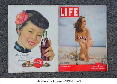 AMELAND, DUTCH - 22JULY 2017.: International magazine LIFE. August 2, 1948 and retro press advertising COCA COLA.