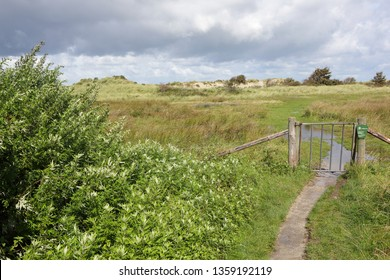 Ameland, Dutch - 4 April 2019.: Pasture on island Ameland. and travel information sign.