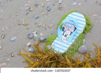 Ameland, Dutch - July 3, 2018.:  Minnie Mouse on little children shoe, North sea beach, Holland