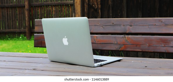 Ameland, Dutch - July 31, 2018.: MacBook Air on wooden table