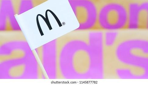 Ameland, Holland - 21 Jun 2018.: Mc Donald flag and world map. McDonald's Corporation is the world's largest chain of hamburger fast food restaurants.
