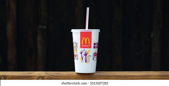 AMELAND, HOLLAND, DUTCH - JANUARY 12, 2016: McDonalds plastic cups for soda. McDonald's Corporation is the world's largest chain of hamburger fast food restaurants.