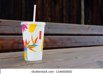 AMELAND, HOLLAND, DUTCH - JANUARY 12, 2016: McDonalds plastic cups for soda. McDonald's Corporation is the world's largest chain of hamburger fast food restaurants.