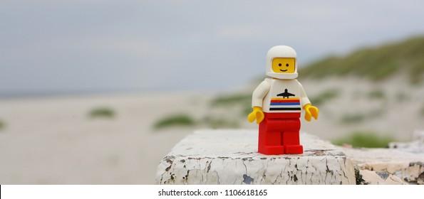 Ameland, Holland - Plastic toy LEGO man on the beach. LEGO