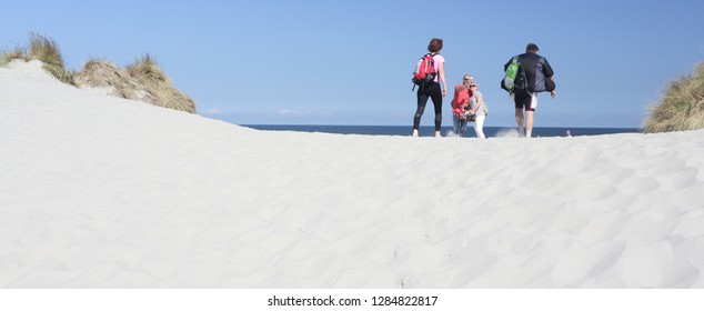 Ameland, Netherland - 2 October 2018.: Sand beach on island Ameland and people