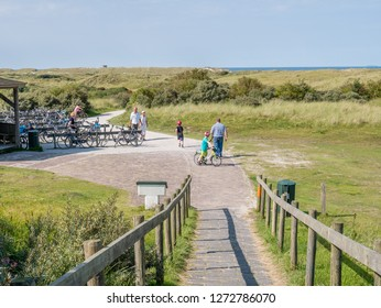 AMELAND, NETHERLANDS - AUG 27, 2017: People and bicycles in dunes of nature reserve Het Oerd on West Frisian island Ameland, Friesland, Netherlands