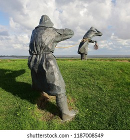 Ameland, The Netherlands - August 3 2018: A statue called the dike guards on Wadden island Ameland