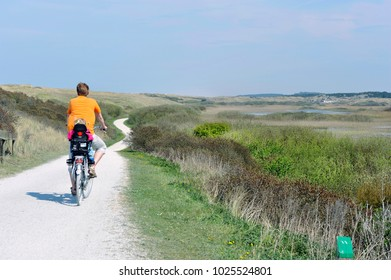 ameland, netherlands, cyclist on bike path
