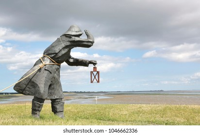 Ameland, The Netherlands - July 31 2015: A statue called the dike guards on Wadden island Ameland