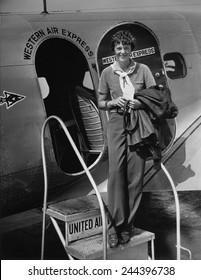 Amelia Earhart 1897-1937 standing in the door of a Western Airlines planes in California as she embarks to New York to make her first New York first public appearance at Carnegie Hall. 1930s.